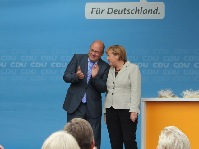 Steffen Kampeter zusammen mit Bundeskanzlerin Angela Merkel in Minden.